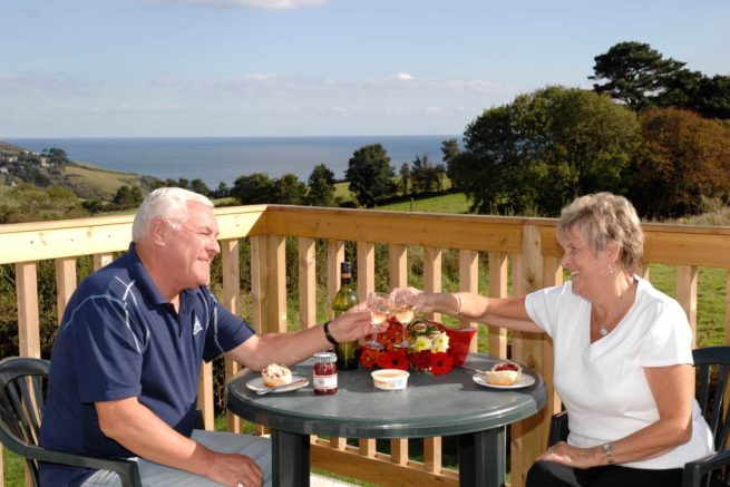 Outdoor-couple-drinking-sea-view